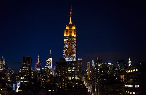 "Large images of endangered species are projected on the south facade of The Empire State Building, Saturday, Aug. 1, 2015. The large scale projections are in part inspired by and produced by the filmmakers of an upcoming documentary called ""Racing Extinction.""  (AP Photo/Craig Ruttle)"
