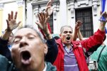 People gathered outside Guatemala's House of Congress cheer as they hear the announcement that lawmakers voted to withdraw President Otto Perez Molina's immunity of prosecution, in Guatemala City, Tuesday, Sept. 1, 2015. A vote of at least 105 of the 158 representatives was required to approve the measure Tuesday. Perez Molina's government has been beset by a series of corruption cases, but until now he has been immune to prosecution as president. (AP Photo/Moises Castillo)