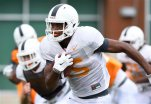 In this Tuesday, Aug. 11, 2015 photo, Tennessee wide receiver Jauan Jennings returns a punt during practice in Knoxville, Tenn.  Tennessee freshman receiver Jauan Jennings is a former quarterback who just switched to his new position this summer. Linebacker Colton Jumper is a walk-on who arrived on campus last year amid no fanfare. Yet both are listed as likely starters when the 25th-ranked Volunteers open the season Saturday, Sept. 5, 2015 against Bowling Green. (Amy Smotherman Burgess/Knoxville News Sentinel via AP)