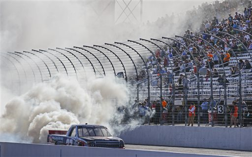 Austin Dillon celebrates with a track burnout after winning the NASCAR Camping World Truck series auto race in Victory Lane at New Hampshire Motor Speedway in Loudon, N.H., Saturday, Sept. 26, 2015  (AP Photo/Cheryl Senter)