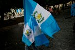 A street vendor walks sells national flags in Constitution Square in Guatemala City, Wednesday, Sept. 2, 2015. As Guatemala's presidential campaign builds to a climax, the biggest rallies of all have been demands to call off the election itself. Tens of thousands have taken to the streets in protest amid a roiling series of corruption scandals that have a former vice president behind bars accused of taking millions in bribes, and President Otto Perez Molina stripped of his immunity from prosecution and facing possible criminal charges and removal from office.  (AP Photo/Esteban Felix)
