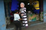 A pinata in the likeness of former Guatemalan president Otto Perez Molina dressed in prison garb is displayed for sale by Mirna Berducido in down town Guatemala City, Thursday, Sep. 3, 2015. Balducido who made the pinata 2 days ago expects to earn about $24 from the sale, as the former president is taken into custody on corruption charges. (AP Photo/Esteban Felix)