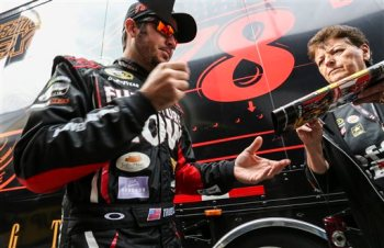 Driver Martin Truex Jr. signs autographs for fans before practice for Sunday's NASCAR Sprint Cup series auto race at New Hampshire Motor Speedway in Loudon, N.H., Friday, Sept. 25, 2015  (AP Photo/Cheryl Senter)