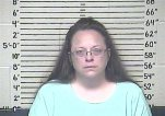 This Thursday, Aug. 3, 2015 photo made available by the Carter County Detention Center shows Kim Davis. The Rowan County, Ky. clerk went to jail Thursday for refusing to issue marriage licenses to gay couples, but five of her deputies agreed to comply with the law, ending a two-month standoff. (Carter County Detention Center via AP)