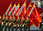Paramilitary policemen carrying flags prepare in front of the Tiananmen Gate ahead of a parade commemorating the 70th anniversary of Japan's surrender during World War II held in front of Tiananmen Gate in Beijing, Thursday, Sept. 3, 2015. (AP Photo/Ng Han Guan)