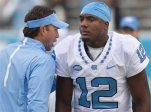 North Carolina coach Larry Fedora talks with quarterback Marquise Williams (12) prior to the Tar Heels' NCAA college football game against Delaware, Saturday, Sept. 26, 2015 at Kenan Stadium in Chapel Hill, N.C. (Robert Willett/The News & Observer via AP) MANDATORY CREDIT