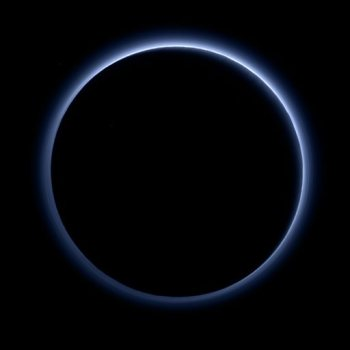 This image released by NASA on Thursday, Oct. 8, 2015, shows the blue color of Pluto's haze layer in this picture taken by the New Horizons spacecraft's Ralph/Multispectral Visible Imaging Camera (MVIC). The high-altitude haze is thought to be similar in nature to that seen at Saturn's moon Titan. This image was generated by software that combines information from blue, red and near-infrared images to replicate the color a human eye would perceive as closely as possible. (NASA/JHUAPL/SwRI via AP