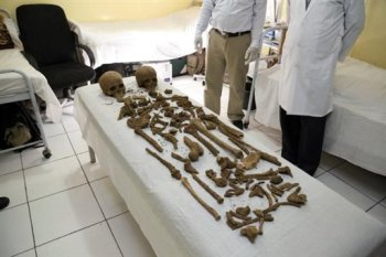 In this image provided by the Afghan Presidential Palace, Monday, Oct. 6, 2015, parts of two human skeletons are seen that were found in the vicinity of Palace No. 1 in the presidential palace compound. Afghanistan's president palace says skulls and bones belonging to two bodies have been uncovered beneath a kitchen during renovation work on the palace grounds. The gender, cause of death and identity of the skeletons are a mystery. (Afghan Presidential Palace via AP)