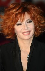 """FILE - In this Jan. 22, 2011 file photo, French singer Mylene Farmer arrives at the Cannes festival palace, in Cannes, southeastern France.  Sting and Farmer play steamy lovers in a new music video for their duet. In person, the duo play like old friends who kiss on the cheek. Farmer re-made Sting's 2003 song, """"Stolen Car,"""" and released the single last Sept. 2015.(AP Photo/Lionel Cironneau)"""
