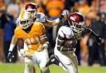 Arkansas running back Alex Collins (3) scores a touchdown past Tennessee linebacker Darrin Kirkland Jr. (34) during the first half of an NCAA college football game at Neyland Stadium in Knoxville, Tenn. on Saturday, Oct. 3, 2015. (Michael Patrick/Knoxville News Sentinel via AP)