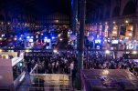 """Participants of a silent disco dance with headsets at the railway station Gare du Nord, turned into a giant nightclub, during the 14th edition of the Paris cultural event """"Nuit Blanche,"""" or """"Sleepless Night,"""" in Paris early Sunday, Oct. 4, 2015. (AP Photo/Kamil Zihnioglu)"""