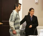 FILE - In this Sept. 11, 2015, file photo, Michael Slager, left, stands as one of his attorneys, Cameron Blazer, guides him toward the podium in Charleston, S.C. Slager is charged in the April 4 death of Walter Scott after a traffic stop. City officials in South Carolina approved a $6.5 million settlement Thursday, Oct. 8, 2015, with the family of Scott. (Leroy Burnell/The Post And Courier via AP, File) MANDATORY CREDIT