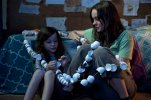"""In this image released by A24 Films,  Brie Larson, right, and Jacob Tremblay appear in a scene from """"Room."""" (George Kraychyk/A24 Films via AP)"""