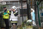 Emergency services attend the scene of a fire in Carrickmines, Dublin, Ireland, Saturday, Oct. 10, 2015.  Police say nine people, including an infant, have died in a fire at a mobile home camp for Ireland's native Gypsies. Detectives say they have yet to establish a cause for Saturday's fire at a Dublin council-run housing site for Irish Gypsies, who in Ireland are known as ``travelers.''  (AP Photo/Peter Morrison)