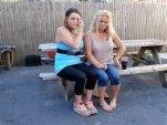 In this Sept. 18, 2015, photo, Kylee Moriarty, left, and her mother, Jackie Law, sit together outside the halfway house in Boston where Moriarty resided. This was their first meeting in person in more than a year. Moriarty is among more than 200 addicts taking advantage of a unique program offered by police in Gloucester, in which heroin addicts are fast-tracked into treatment rather than arrested. (AP Photo/Philip Marcelo)