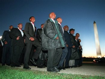 FILE - In this Monday, Oct. 16, 1995 file photo, members of the Nation of Islam march toward the Capitol in Washington. The Washington Monument is at background right. (AP Photo/Greg Gibson)