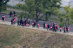 People carrying bouquets of decorative flowers walk towards Kim Il Sung Square, Saturday, Oct. 10, 2015, in Pyongyang, North Korea. North Korea is holding what is expected to be one of its biggest celebrations ever Saturday for the 70th anniversary of its ruling party's creation, an attention-getting event that is the government's way of showing the world and its own people the Kim dynasty, now in its third generation, is firmly in control and its military a power to be reckoned with. (AP Photo/Charles Dharapak)