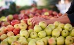 In this photo taken Oct. 5, 2014, apples are displayed at a farmers market in Arlington, Va. A common pesticide used on citrus fruits, almonds and other crops would be banned under a proposal announced Friday by the Environmental Protection Agency. The proposal would prohibit use of chlorpyrifos, a widely used insecticide that is sprayed on a variety of crops including oranges, apples, cherries, grapes, broccoli and asparagus.  (AP Photo/J. Scott Applewhite)