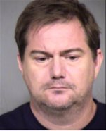This photo provided by the Maricopa County Sheriffs office shows Brian Woolsey.  Peoria police have arrested Woolsey, 45,  and his wife, Jennifer Woolsey. Brian Woolsey faces charges of sexual conduct with a minor and sexual exploitation of a minor. His wife is being charged with failing to report sexual abuse. (Maricopa County Sheriffs office)