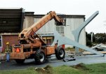 The remains of a concrete canopy that collapsed sit in front of North Iredell High School on Saturday, Oct. 3, 2015, in Olin, N.C. A box truck hit one of the canopy supports and the awning then fell on a group of band students. (AP Photo/Skip Foreman)