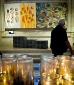 "CORRECTS DATE THAT EXHIBITION ENDS TO APRIL 3, NOT APRIL 4 - Artist Tattfoo Tan's installation ""Nemre,"" appearing among the works of 30 artists in the multimedia exhibition ""The Value of Food: Sustaining a Green Planet"" at the Cathedral of St. John the Divine, occupies a wall bay near a candlelit prayer station, Wednesday, Oct. 7, 2015, in New York.  The exhibition, installed in the cathedral's seven chapels and 14 bays, explores food accessibility, sustainability and other food-related issues and runs through April 3, 2016.  (AP Photo/Bebeto Matthews)"