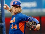 New York Mets pitcher Noah Syndergaard has the name Thor monogrammed on his glove as he throws at batting practice for the Major League Baseball World Series against the Kansas City Royals Monday, Oct. 26, 2015, in Kansas City, Mo. (AP Photo/Matt Slocum)