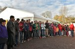 Migrants are standing in front a tent as they wait for the visit of German President Joachim Gauck in Bergisch Gladbach, western Germany, Thursday, Nov. 12, 2015. (AP Photo/Martin Meissner)