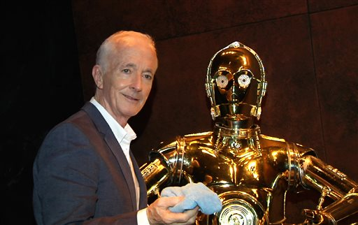 "In this image taken from video, actor Anthony Daniels, who portrays C-3PO in the ""Star Wars"" films, appears with his robot counterpart at a preview for the ""Star Wars and the Power of Costume"" exhibition at Discovery Times Square Museum on Wednesday, Nov. 11, 2015. Daniels returns again for ""Star Wars: Episode VII - The Force Awakens,"" in U.S. theaters on Dec. 18. (AP Photo/Bruce Barton)"