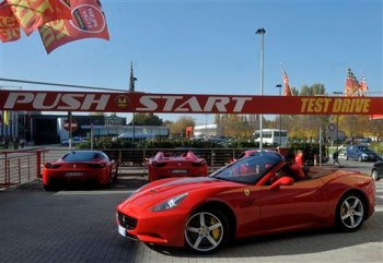 In this photo taken on Friday, Nov. 6, 2015, Ferrari cars are parked at the Push-Start test-drive service, in Maranello, Italy. Just outside the gates of the Ferrari Museum in the carmaker's birthplace of Maranello, entrepreneurial spirit is clashing with communal concerns for safety and even decorum as a growing gaggle of unaffiliated, independent Ferrari test-drive businesses say they are fighting for survival amid tightening rules imposed by the city. (AP Photo/Marco Vasini)