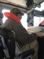 A man rests after he was rescued Thursday, Nov. 19, 2015, by personnel from Coast Guard Station Hobucken near Raccoon Island, N.C. The man and his pets were rescued after his sailboat ran aground near the island. (U.S. Coast Guard photo by Petty Officer 2nd Class Miles P. Beene)