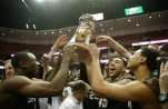 Michigan State players hold up the Wooden Legacy trophy after defeating Providence in an NCAA college basketball game at the Wooden Legacy tournament, Sunday, Nov. 29, 2015, in Anaheim, Calif. (AP Photo/Jae C. Hong)