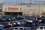 Cars fill the parking lot of a Costco store, Tuesday, Nov. 24, 2015, in Seattle. Health authorities say chicken salad from Costco has been linked to at least one case of E. coli in Washington state.  (AP Photo/Ted S. Warren)