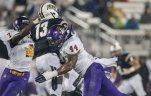 East Carolina linebacker Zeek Bigger (44) hits Central Florida quarterback Justin Holman (13) after his throw during the first half of an NCAA college football game  Thursday, Nov. 19, 2015, in Orlando, Fla. (AP Photo/Willie J. Allen Jr.)