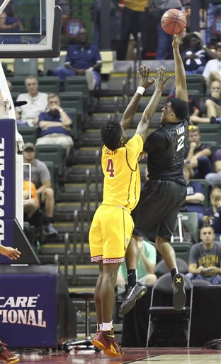 Xavier forward James Farr (2) shoots the ball over Southern California forward Chimezie Metu (4) during the first half of an NCAA college basketball game Friday, Nov. 27, 2015, in Orlando, Fla. (AP Photo/Willie J. Allen Jr.)