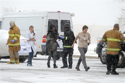 People are escorted away after a deadly shooting at a Planned Parenthood clinic Friday, Nov. 27, 2015, in Colorado Springs, Colo. A gunman opened fire at the clinic on Friday, authorities said, wounding multiple people. (Daniel Owen/The Gazette via AP) MAGS OUT; MANDATORY CREDIT