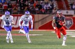 New Mexico's Jhurell Pressley runs past Air Force defenders on his way to a touchdown during the first half of an NCAA college football game, Saturday, Nov. 28, 2015, in Albuquerque, N.M. (AP Photo/Juan Labreche)