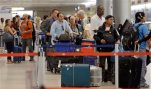 FILE - In this May 22, 2015 file photo, travelers wait in line to check in their luggage at Miami International Airport in Miami.  Heading into winter, fliers should take extra precautions with their checked luggage, December and January are traditionally the worst months for lost bags. (AP Photo/Alan Diaz)