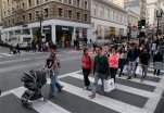 In this Sunday, Nov. 22, 2015, photo, shoppers cross a street in San Francisco. It used to be that Black Friday kicked off the holiday shopping season, but now Thanksgiving shopping has become the new tradition. (AP Photo/Marcio Jose Sanchez)