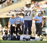 San Diego Chargers Jimmy Wilson signals an incomplete pass as Jacksonville Jaguars Allen Hurns lays on the field injured after the play in the second half of an NFL football game Sunday, Nov. 29, 2015, in Jacksonville, Fla. (Bob Self/The Florida Times-Union via AP) MANDATORY CREDIT