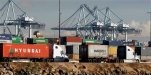 FILE - In this Feb. 23, 2015 file photo, trucks hauling containers leave the Port of Los Angeles. The Commerce Department releases international trade data for September 2015 on Wednesday, Nov. 4, 2015. (AP Photo/Nick Ut, File)