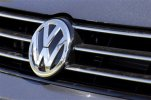 "FILE - In this Thursday, Sept. 24, 2015, file photo, the grille of a Volkswagen car for sale is decorated with the iconic company symbol in Boulder, Colo. Germany's Volkswagen, already reeling from news that it had cheated on U.S. tests for nitrogen oxide emissions, said Tuesday, Nov. 3, that an internal investigation had revealed ""unexplained inconsistencies"" in the carbon dioxide emissions from 800,000 vehicles that could cost the company another 2 billion euros ($2.2 billion). The revelation comes after VW's admission in September that it rigged emissions tests for four-cylinder diesel engines on 11 million cars worldwide, including almost 500,000 in the U.S. It has already set aside 6.7 billion euros ($7.4 billion) to cover the costs of recalling those vehicles. (AP Photo/Brennan Linsley, File)"