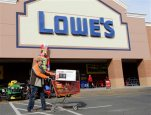 FILE - In this Tuesday, Nov. 18, 2014, file photo, a customer leaves a Lowe's home improvement store in Matthews, N.C. Lowe's reported Wednesday, Nov. 18, 2015, that the company's third-quarter results beat analysts' estimates as its sales grew, buoyed by the ongoing housing market recovery. (AP Photo/Chuck Burton)