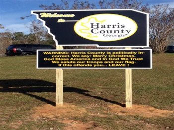 "This provided by D&S Sign Company, shows a new welcome sign in Harris County, Ga., near Hamilton, Ga. Sheriff Mike Jolley installed the sign Tuesday, Nov. 24,. Jolley tells local media that he paid for the sign himself and wanted to give voice to what he considers to be a ""silent majority.""  (D&S Sign Company via AP)"