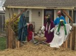 This Dec. 4, 2015 photo shows the accessory structure housing the zombie nativity scene in Rossmoyne, Ohio.    According to The Cincinnati Enquirer, the creator of the zombie nativity set Jasen Dixon, was officially cited Dec. 3 for his accessory structure on the front lawn of his home. The roof of the structure was removed Dec. 4, bringing it into compliance with zoning regulations.  (Sheila Vilvens/The Cincinnati Enquirer via AP)  MANDATORY CREDIT;  NO SALES