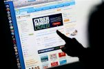 FILE - In this Monday, Nov. 29, 2010, file photo, a consumer looks at Cyber Monday sales on her computer at her home in Palo Alto, Calif.  Online sales growth so far this holiday season is surpassing growth in sales at physical stores, according to First Data, which analyzed online and in-store payments from Oct. 31 through Monday, Dec. 14, 2015. (AP Photo/Paul Sakuma, File)