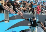 Carolina Panthers quarterback Cam Newton celebrates with fans after defeating the Atlanta Falcons 38-0 in an NFL football game in Charlotte, N.C., Sunday, Dec. 13, 2015. (Curtis Compton/Atlanta Journal-Constitution via AP)  MARIETTA DAILY OUT; GWINNETT DAILY POST OUT; LOCAL TELEVISION OUT; WXIA-TV OUT; WGCL-TV OUT; MANDATORY CREDIT