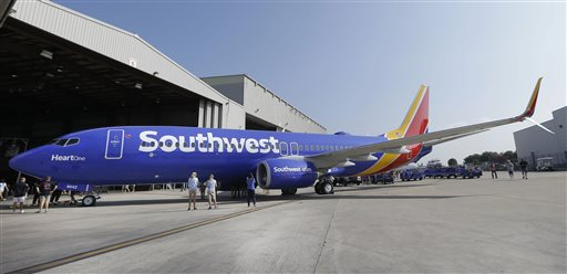 FILE - In this Sept. 8, 2014, file photo, a Southwest Airlines plane sits outside a hangar at Love Field in Dallas. Southwest Airlines reports quarterly financial results, Thursday, Jan. 21, 2016. (AP Photo/LM Otero, File)