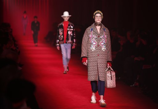 Models wear creations for Gucci men's Fall-Winter 2016-2017 collection, part of the Milan Fashion Week, unveiled in Milan, Italy, Monday, Jan. 18, 2016. (AP Photo/Antonio Calanni)