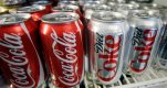 """FILE - In this March 17, 2011, file photo, cans of Coca-Cola and Diet Coke sit in a cooler in Anne's Deli in Portland, Ore. Coca-Cola announced in Paris on Tuesday, Jan. 19, 2016, that a campaign, called """"Taste the Feeling,"""" will unite its most well-known slate of drinks under a single marketing theme. (AP Photo/File)"""
