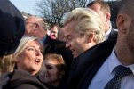 """Firebrand Dutch lawmaker Geert Wilders talks to a woman after hands out """"self-defense sprays"""" to women fearful of being attacked by migrants in the wake of the New Year's Eve sexual assaults in Cologne, in the center of Spijkenisse, near Rotterdam, Netherlands, Saturday, Jan. 23, 2016. Saturday's event was a trademark headline-grabbing foray into the Dutch public by the leader of the Freedom Party. Such publicity stunts have landed him atop Dutch opinion polls a year away from parliamentary elections in the Netherlands. (AP Photo/Peter Dejong)"""